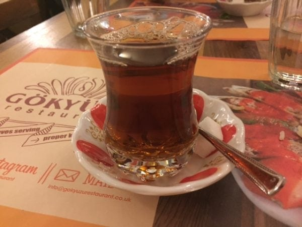turkish tea in a small glass with saucer