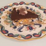 slice of chocolate pie with ice cream on a plate