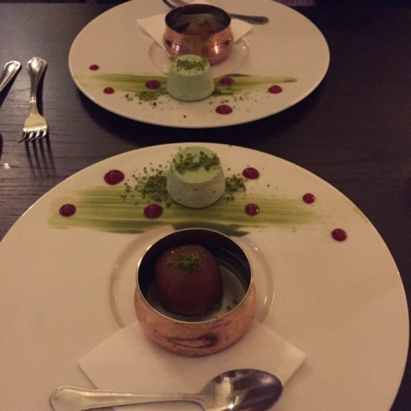 gulab jamun and pistachio kulfi on a white plate
