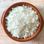 boiled rice in brown bowl