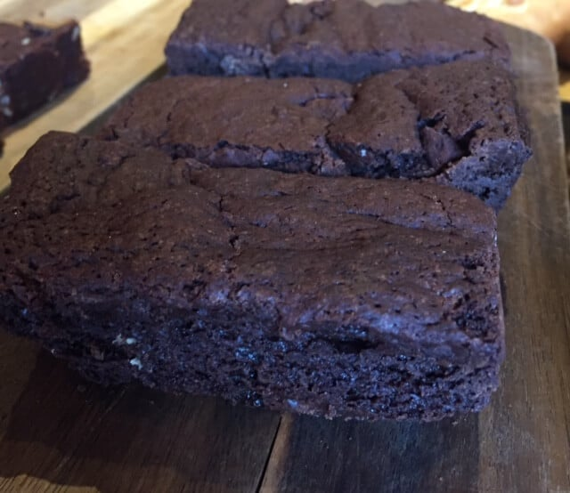 3 rectangular slices of brownies on wooden board