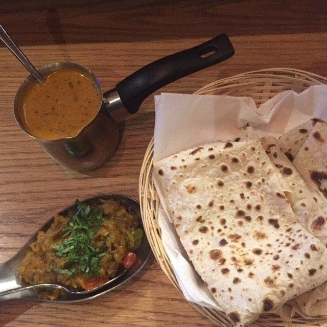 small bowl of dal, vegetable and roti