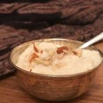 Kheer in a small silver bowl