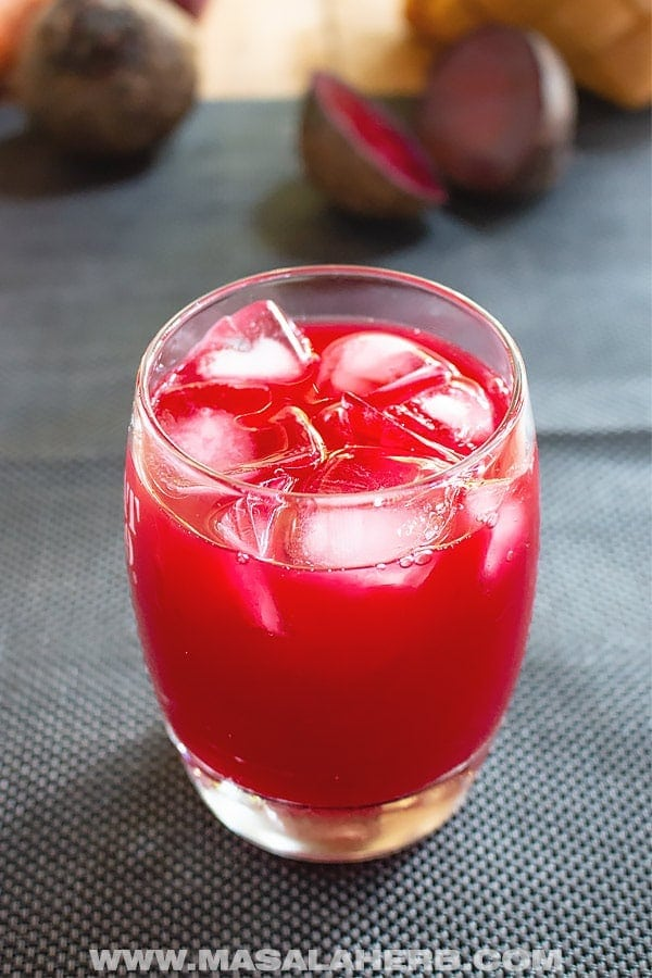 glass of juice with ice cubes