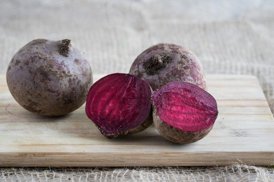 beets, sliced and whole, on a chopping board
