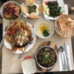 Table spread with Middle eastern dishes