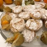 Ricciarelli on a plate with gooseberries