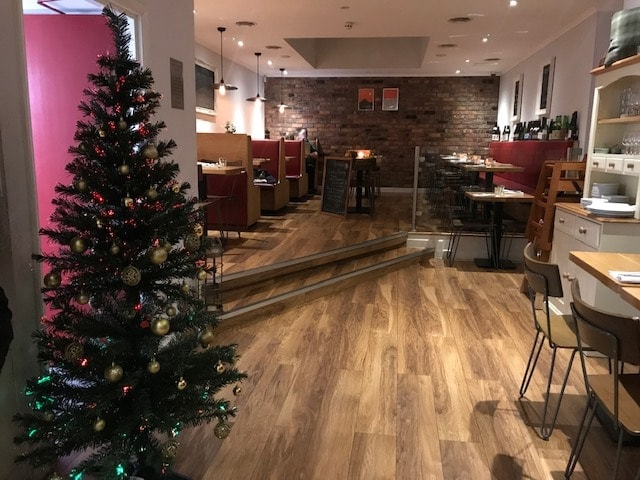 Christmas tree and interior of restaurant