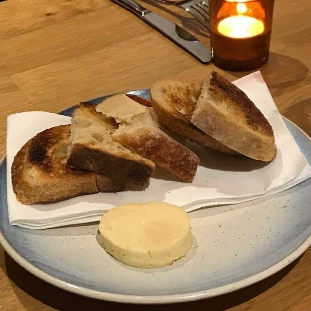 slices of bread and butter on a plate