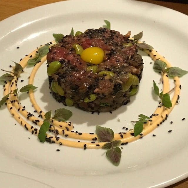 plate of steak tartare with quail egg