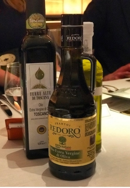 three bottles of olive oil on the dining table