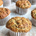 Banana muffins on wooden counter.
