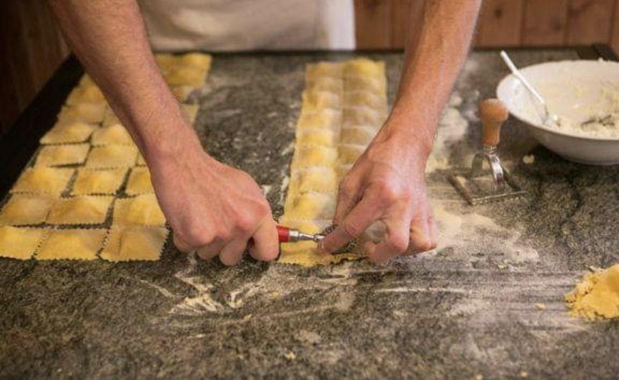 close up of a person making ravioli