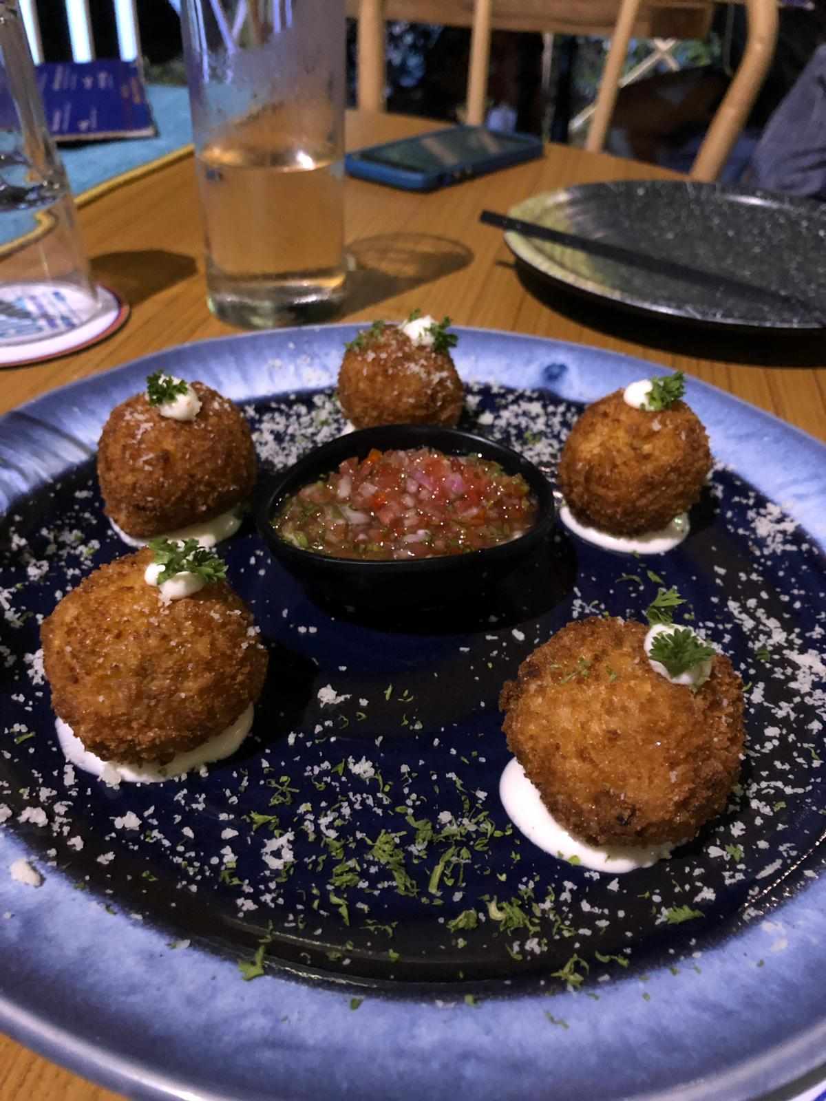 blue plate with 5 risotto balls