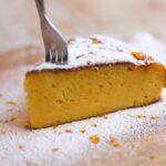 fork in a slice of orange cake