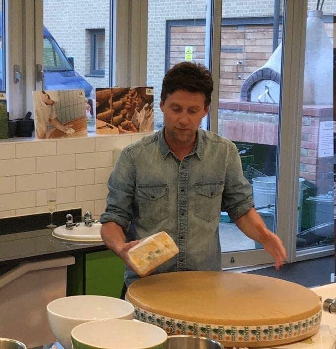 large wheel of Comté cheese