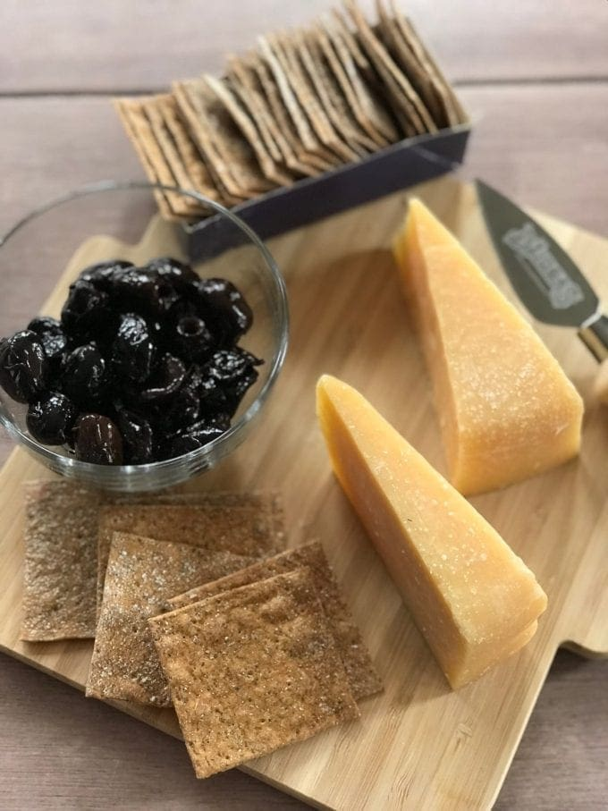 cheese board with wedges of Dziugas
