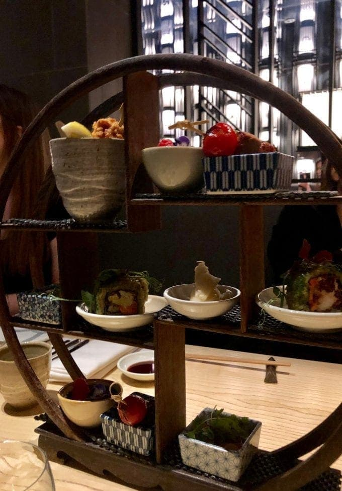 side view of tea stand containing small dishes