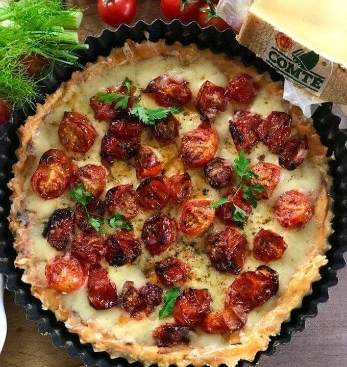 tomato tart next to a piece Comté cheese