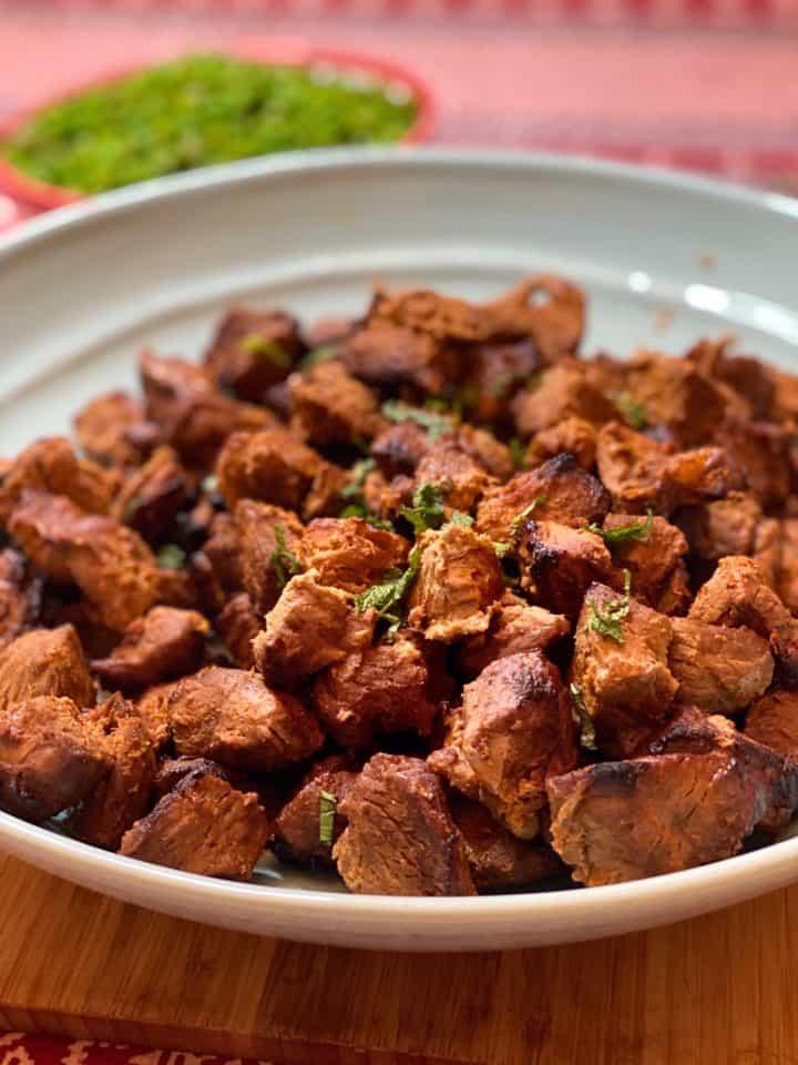 tandoori lamb in a large blue dish