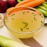 Chicken Stock in a glass bowl