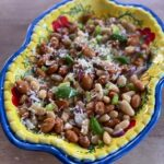 Image of two bean salad on a colourful plate.
