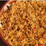 closeup Mexican rice in decorated bowl