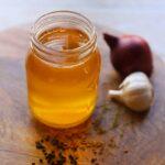 Yellow Niter kibbeh in a glass jar